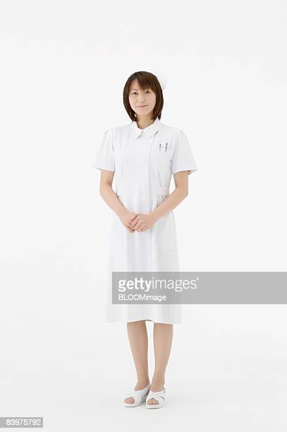 portrait of nurse, studio shot - nurse and portrait and white background and smiling and female and looking at camera stock pictures, royalty-free photos & images