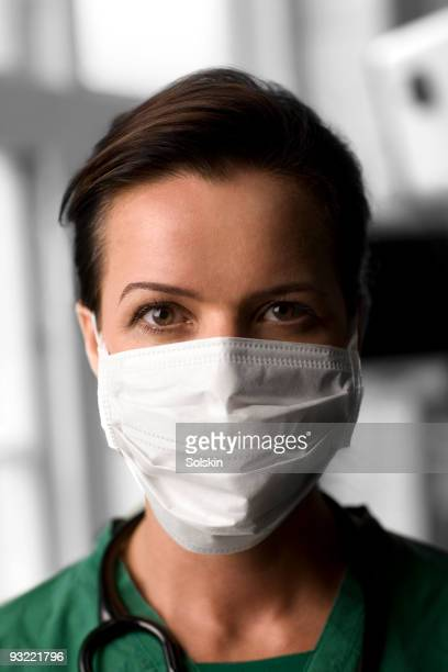 portrait of nurse with mouth covering - one mature woman only stock pictures, royalty-free photos & images