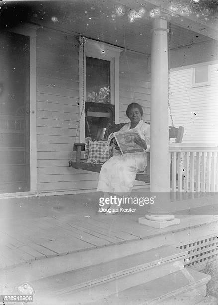 Widow Odessa Price of Kansas City Kansas married John Johnson of Lincoln on August 20 1918 Here Odessa sits on the porch swing of the Johnson home in...