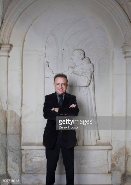 Portrait of oenologist Richard Geoffroy in front of a frieze of benedictine monk Dom Perignon at the Abbey of St Peter Hautvillers France October 2010