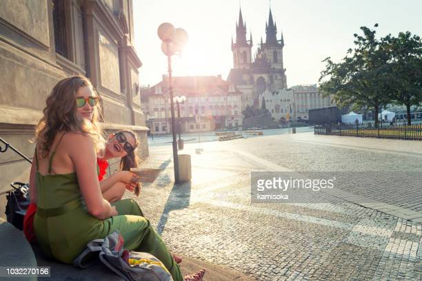 portrait of of best girlfriends on vacation in front of tyn church - prague stock pictures, royalty-free photos & images
