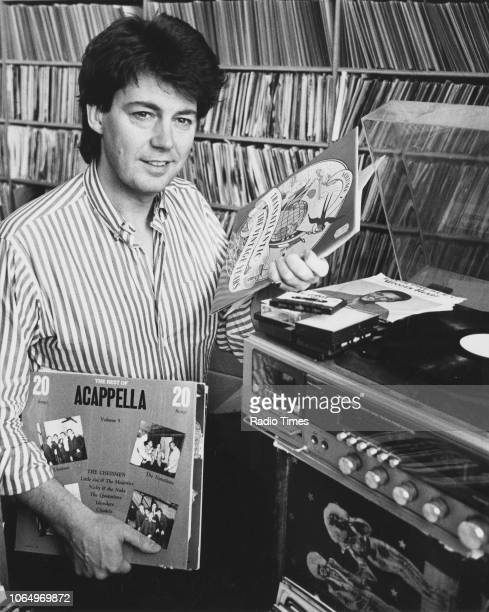 Portrait of of radio disc jockey Mike Read playing records January 1989