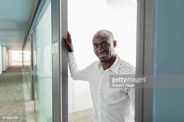 portrait of office colleague in doorway - formalwear stock pictures, royalty-free photos & images