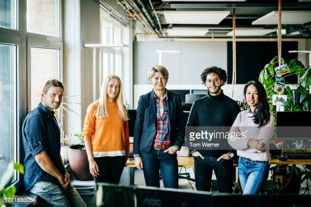 portrait of office management team smiling - mid adult women stock pictures, royalty-free photos & images
