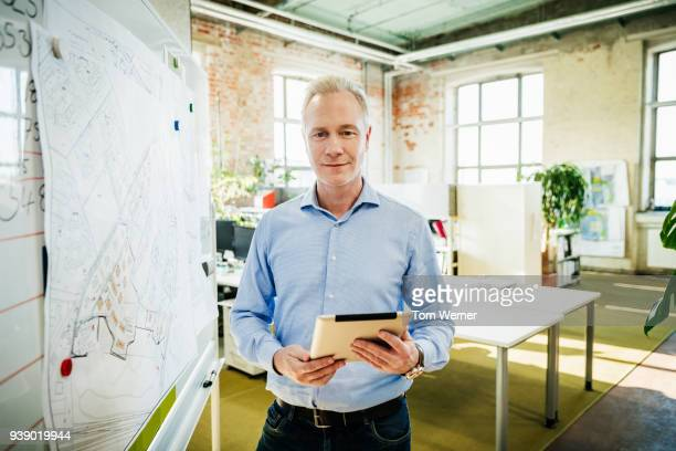 Portrait Of Office Manager Holding A Tablet