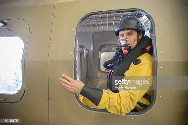 portrait of offshore oil worker in simulated helicopter, training in sea ditching survival in pool facility - inside helicopter stock pictures, royalty-free photos & images