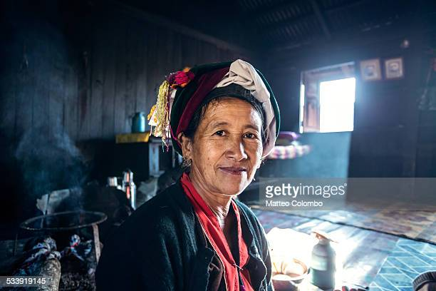 Portrait of old asian woman inside her house
