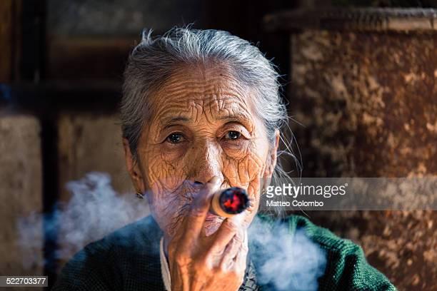 portrait of old burmese woman smoking big cigar - beautiful women smoking cigars stock photos and pictures