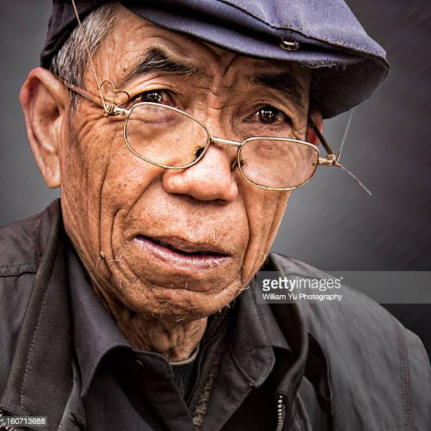 Portrait of Old Chinese Man with glass