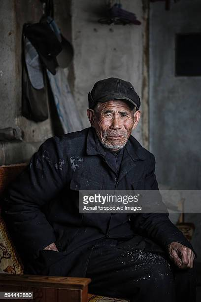 Portrait of old farmer sad, China