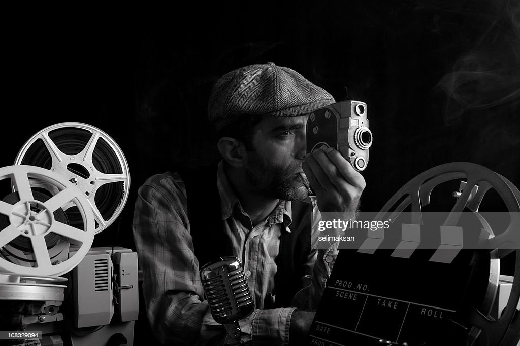 Portrait Of Old Fashioned Cinema Director Camera In Hand : Stock Photo