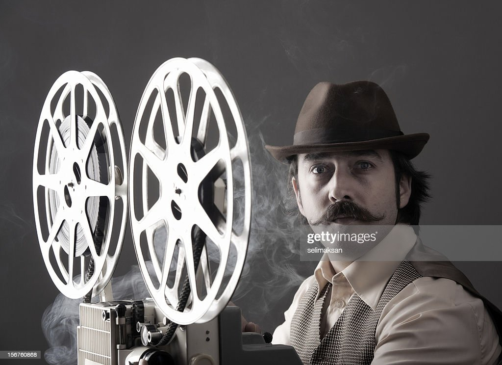 Portrait of old Fashioned Cinematographer : Stock Photo