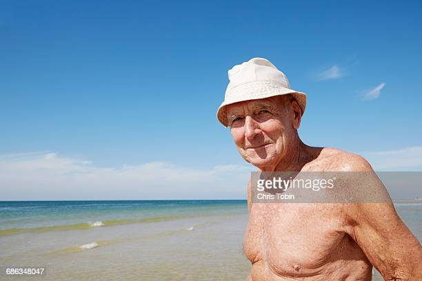 portrait of old man at the beach - old nudists stock pictures, royalty-free photos & images