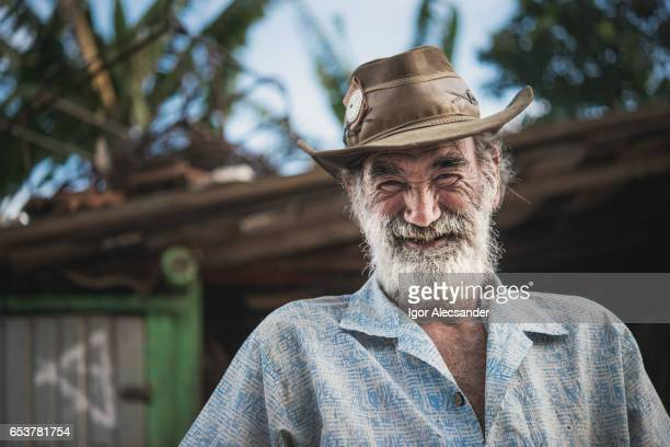 portrait of old man, wagon horse worker, brazil - redneck stock photos and pictures