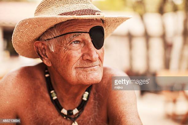 Portrait of old man with eye patch