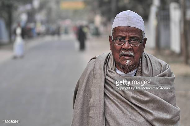 portrait of old man wrapped in shawl - winter bangladesh stock photos and pictures