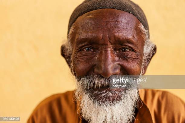 portrait of old muslim man in southern egypt - egyptian culture stock photos and pictures
