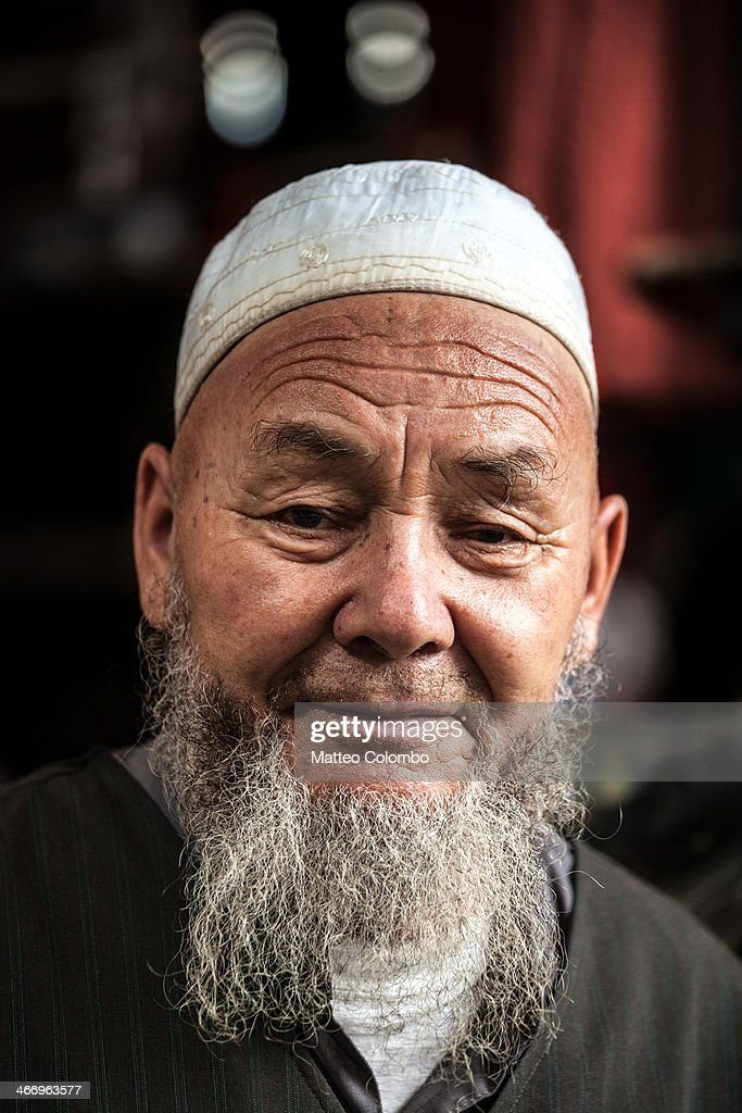 Portrait of old uyghur man, Xinjiang, China : News Photo