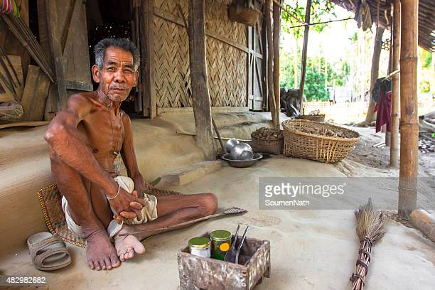 portrait of old tribal man sitting in his hut - tripura state stock pictures, royalty-free photos & images