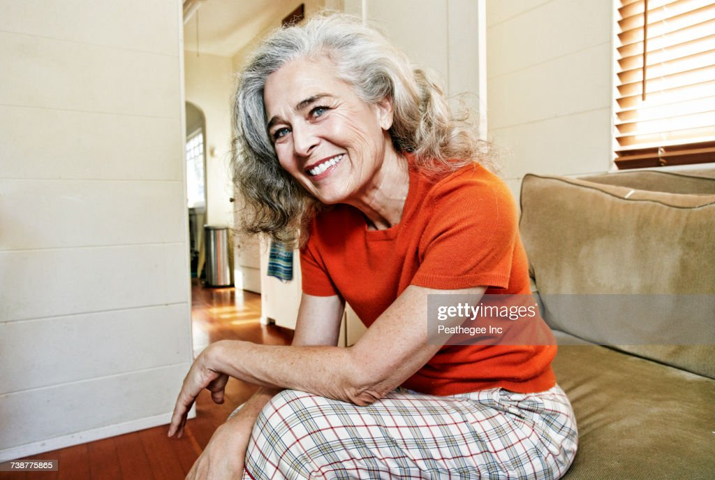 Portrait of older Caucasian woman sitting on sofa : Stock-Foto