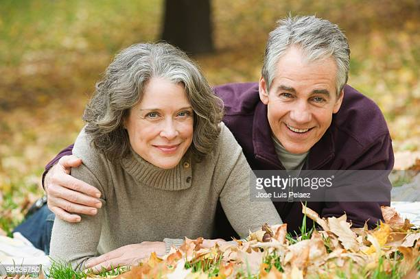Portrait of older couple on the grass
