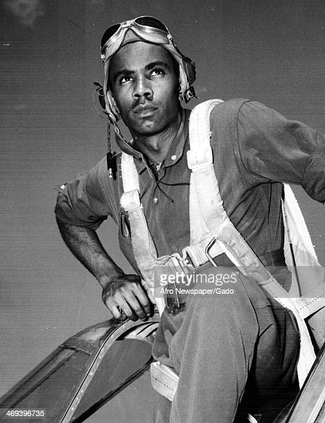 Portrait of Oliver O Miller Second Lieutenant and Tuskegee Airman as he enters the cockpit of his airplane Tuskegee Alabama 1943