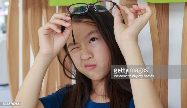 portrait of one girl who has the myopia problem - myopia stock photos and pictures