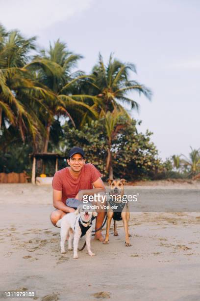 portrait of one man and two dogs looking at camera - latin america stock pictures, royalty-free photos & images