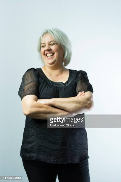 portrait of one mature woman laughing - 50 59 years stock pictures, royalty-free photos & images