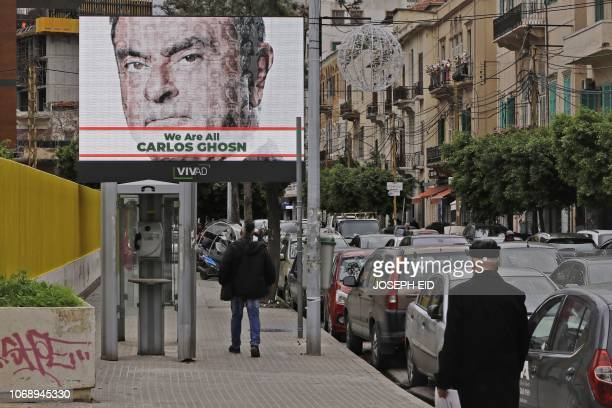 Portrait of ousted Nissan chairman Carlos Ghosn is seen on a publicity billboard in his support at a street in Beirut on December 6, 2018. - Ghosn,...