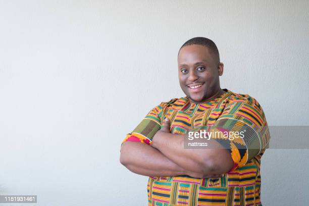 portrait of overweight man in traditional clothing - dashiki stock photos and pictures