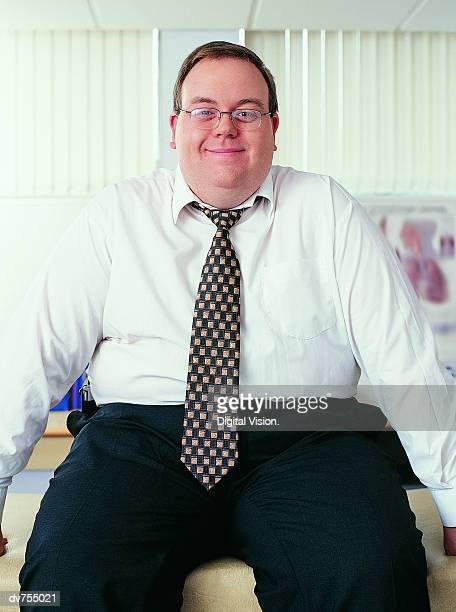 Portrait of Overweight, Smiling Businessman
