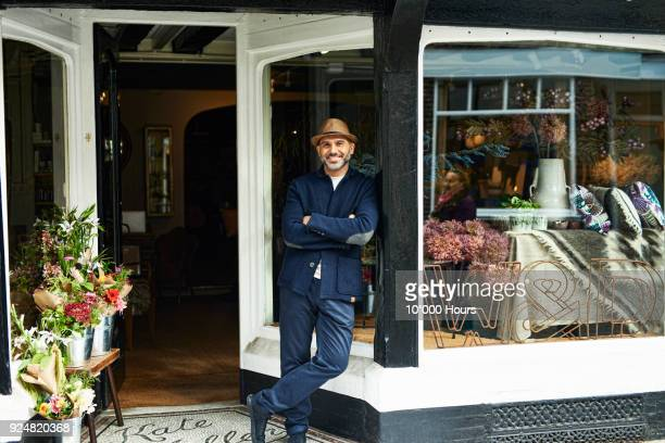 portrait of owner in boutique - store stock pictures, royalty-free photos & images