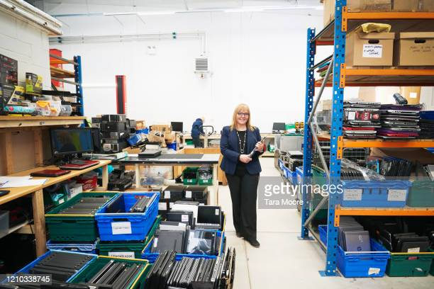 portrait of owner in computer recycling centre - femalefocuscollection stock pictures, royalty-free photos & images