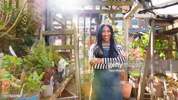 portrait of owner of plant nursery - owner stock pictures, royalty-free photos & images