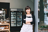 Portrait of owner of sustainable small local business. Shopkeeper of zero waste shop standing on interior background of shop.