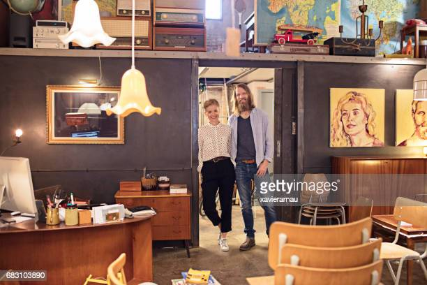 Portrait of owners standing in furniture store