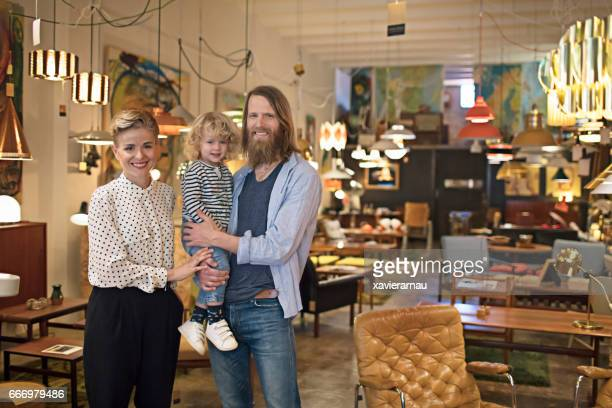 Portrait of owners with son at furniture shop