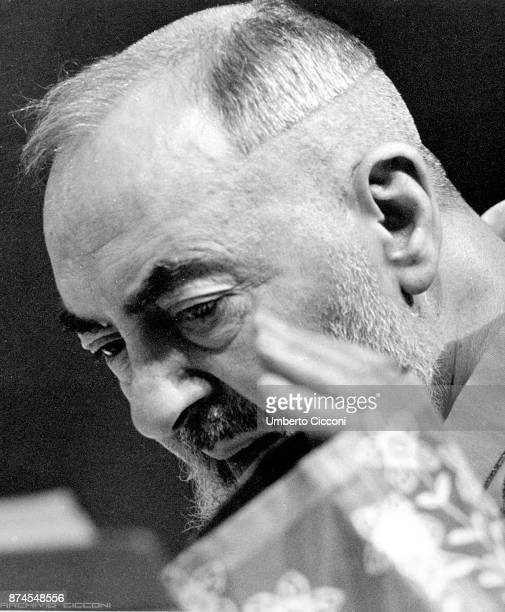 Portrait of Padre Pio while he celebrates the mass at the Sanctuary of Saint Pio of Pietrelcina 1963 Padre Pio was a friar priest stigmatist and...
