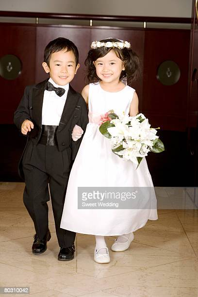 portrait of pageboy and flower girl - pageboy stock pictures, royalty-free photos & images