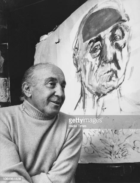 Portrait of painter Feliks Topolski in front of one of his portraits August 23rd 1974