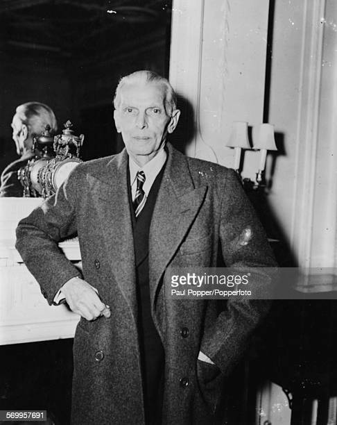 Portrait of Pakistani lawyer and politician Muhammad Ali Jinnah pictured leaning against a mantlepiece in 1946