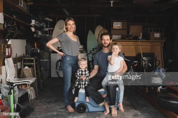 portrait of parents and children in storage room of house - enfant photos photos et images de collection