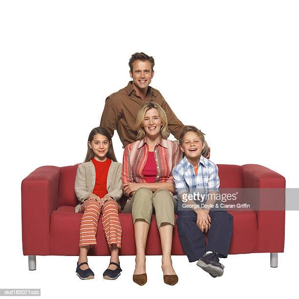 Portrait of parents sitting with their son (10-11) and daughter (11-12)