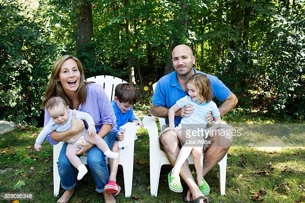 portrait of parents with kids (2-5 months, 2-5) in garden - 2 5 months stock pictures, royalty-free photos & images