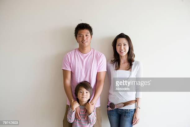 Portrait of parents with son (6-7)