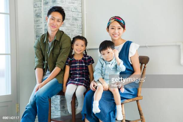 Portrait of parents with two children