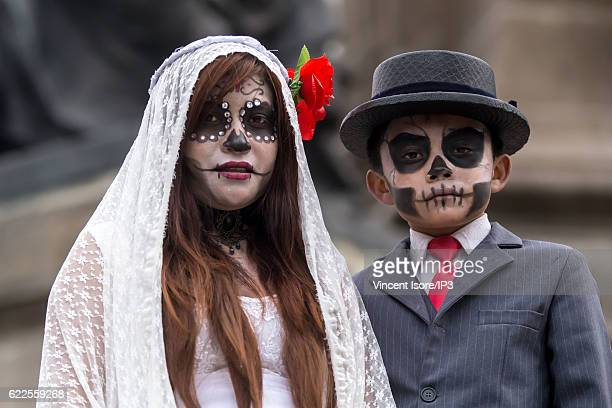 Portrait of participants who wear a skeleton makeup and parade through the streets during the 'Catrinas Parade' a joyful annual event celebrated at...