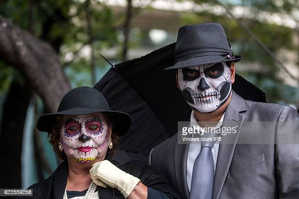 Portrait of participants who wear costumes and parade through the streets during the 'Catrinas Parade' a joyful annual event celebrated at the Day of...