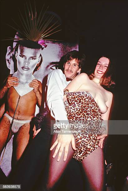Portrait of party goers at Bonds' in Times Square New York New York July 23 1980 One woman wears a leopardprint outfit pulled down to expose her...